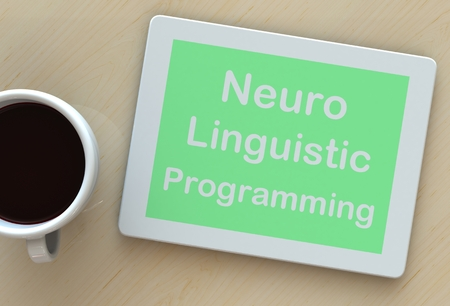 neuro: Neuro Linguistic Programming, message on tablet and coffee on table Stock Photo