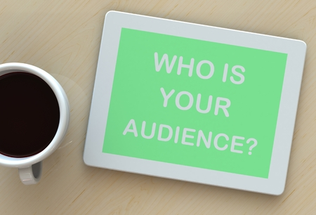 relevance: WHO IS YOUR AUDIENCE, message on tablet and coffee on table Stock Photo