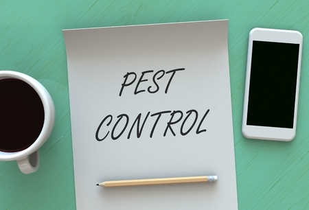 PEST CONTROL, message on paper, smart phone and coffee on table