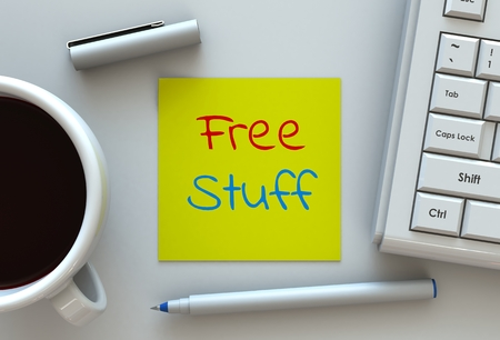 Free Stuff, message on note paper, computer and coffee on table