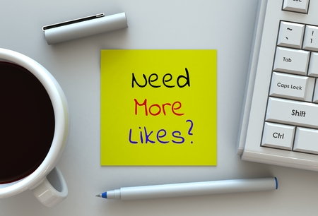 likes: Need More Likes, message on note paper, computer and coffee on table