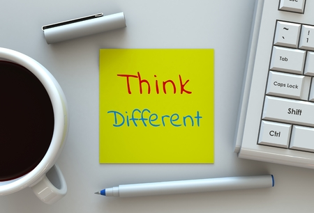 differently: Think Different, message on note paper, computer and coffee on table