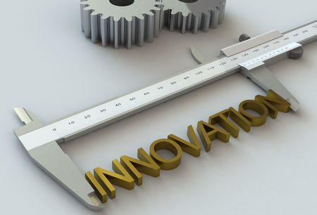 INNOVATION, message on vernier caliper Stock Photo