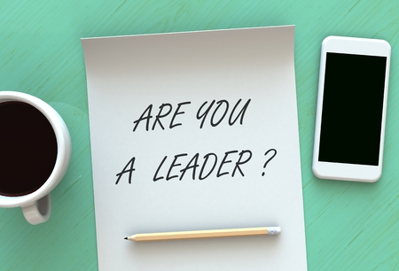 ARE YOU A LEADER, message on paper, smart phone and coffee on table, 3D rendering