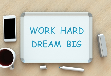 hard day at the office: Work Hard Dream Big, message on whiteboard, smart phone and coffee on table, 3D rendering