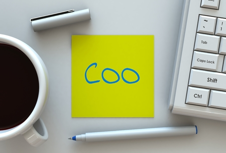 coo: COO, message on note paper, computer and coffee on table Stock Photo