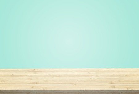 Laminate table top on pastel light blue background can put or montage your products
