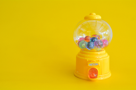 Capsule toy abstract minimal yellow background Stockfoto