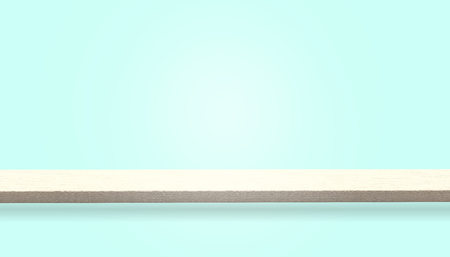 Empty top of wood table or counter isolated on blue background, can be used for display or montage your products