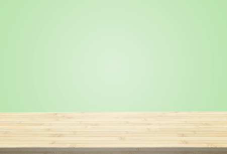 Laminate table top on pastel green background can put or montage your products