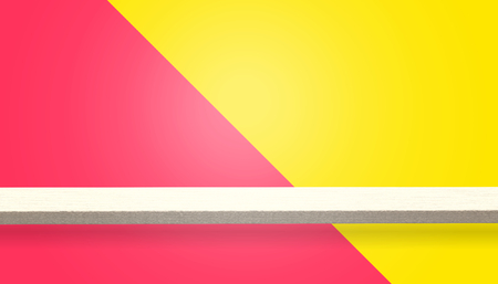 Empty top of wood table or counter isolated on yellow and red background, can be used for display or montage your products
