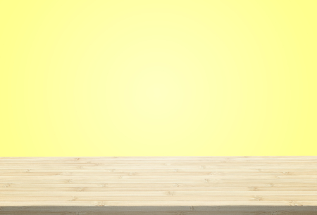Laminate table top on pastel yellow background can put or montage your products