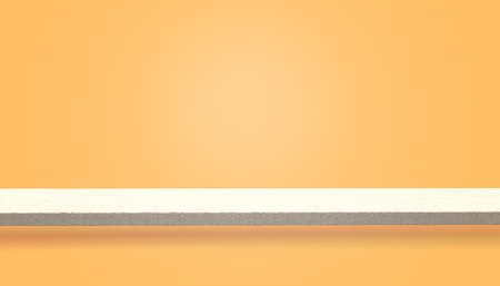 Empty top of wood table or counter isolated on orange background, can be used for display or montage your products