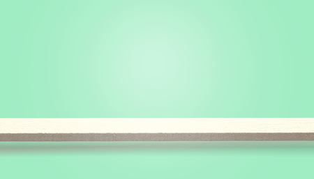 Empty top of wood table or counter isolated on green background, can be used for display or montage your products