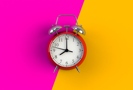 Alarm clock on pink and yellow background, 3D rendering Фото со стока