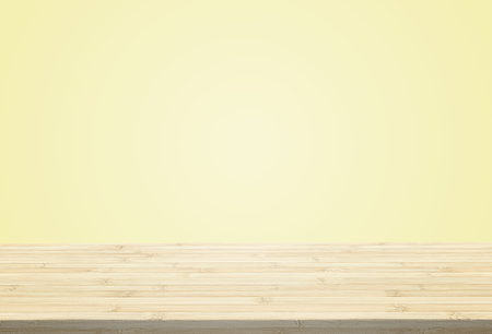 Laminate table top on pastel pale yellow background can put or montage your products