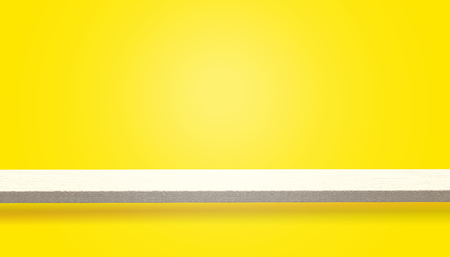 Empty top of wood table or counter isolated on yellow background, can be used for display or montage your products Stock Photo