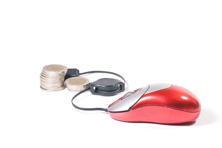 Computer mouse and coin  on white background photo
