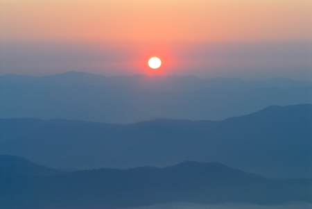Sunrise over mountains photo