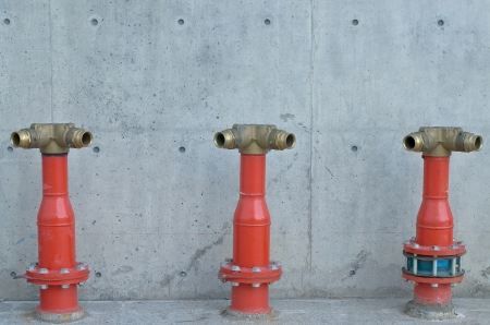 manifold: fire manifold for fire fighting near building Stock Photo