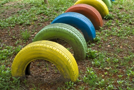 old  tires with colorful paint on a playground