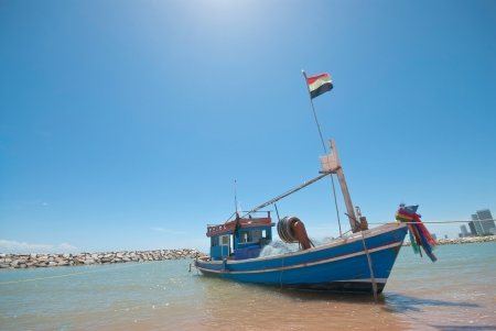 fishing boat on the beach photo