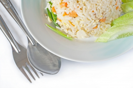 fried rice on dish with spoon and fork