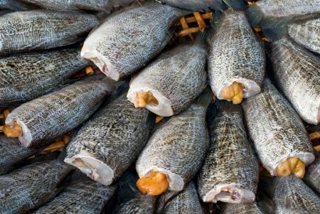 gourami: drying snakeskin gourami fishs in threshing basket