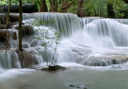 beautiful cascading waterfall over natural rocks Stock Photo
