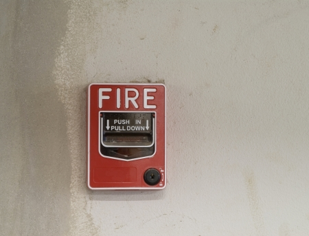 fire alarm manual pull station for  fire alarm system in grunge wall Stock Photo - 15434616