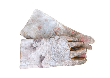 old leather glove on white background photo