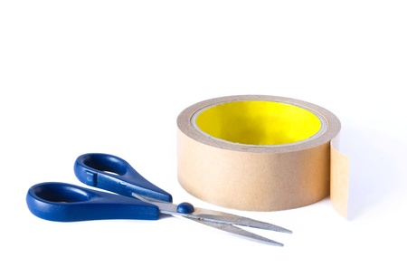 scissors and a roll tape on the white background