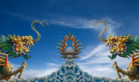 china dragon statue on blue sky Stock Photo