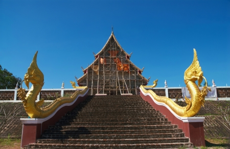 Naka statue on staircase balustrade at Thai buddhist pagoda photo