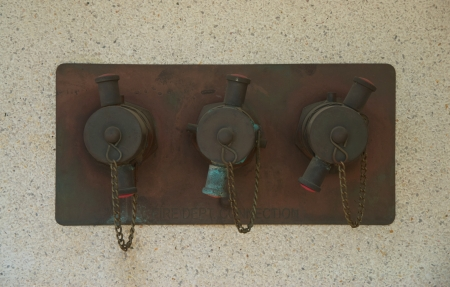 fire department valves on terrazzo wall photo