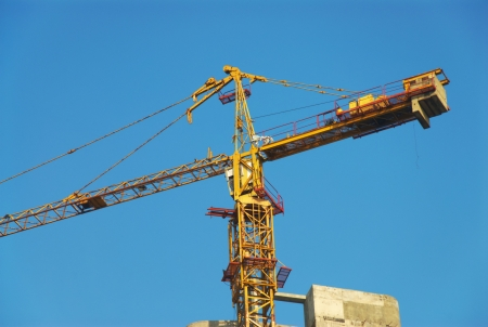 yellow crane and blue sky on construction site