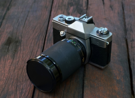 old film SLR camera with lens