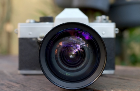 old film SLR camera with lens Stock Photo - 18166210