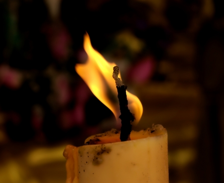 closeup photograph of a candle  flame photo
