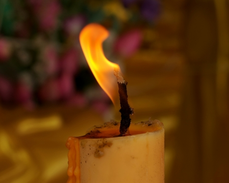 closeup photograph of a candle  flame