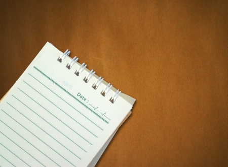 note paper on brown paper background Stock Photo