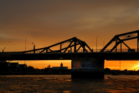 Silhouette of steel bridge over the Chao Phraya River,Bangkok, Thailand photo