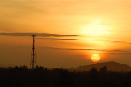 cell tower: golden sky with telecommunication tower Stock Photo