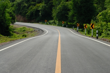 road signs warn for ahead dangerous curve Stock Photo