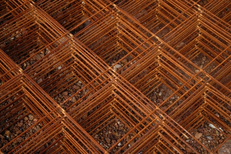 reinforcing: Stack of reinforcing wire mesh in construction site