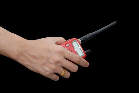 cb phone: portable radio transceiver in hand, isolated on black background Stock Photo