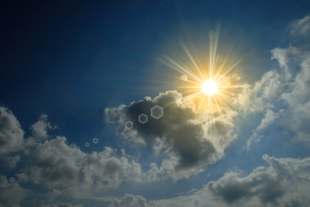 clouds on blue sky with sun rays