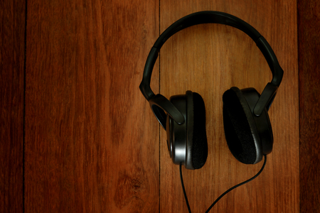 wood floor: headphones on wooden floor Stock Photo