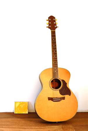 cd case: acoustic guitar and cd case on wooden floor Stock Photo
