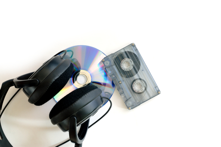 CD cassette tape and earphones on white background